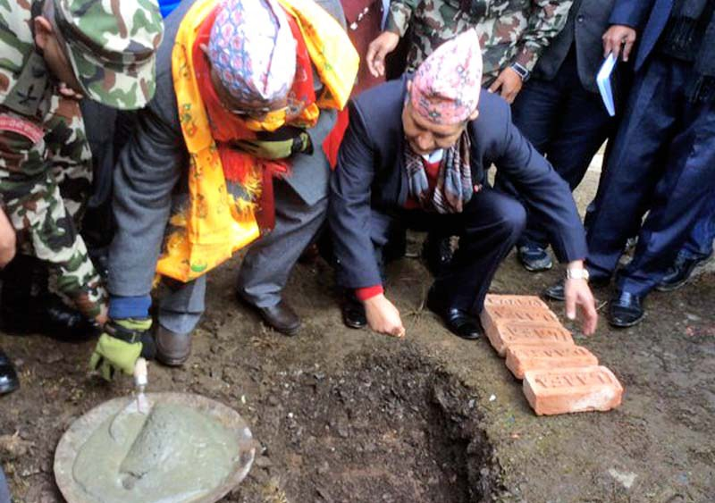 Prime Minister KP Sharma Oli laying the foundation stone of a drinking water and sanitation project for the quake survivors in Barpak of Gorkha on Thursday, December 17, 2015. Photo source: PM's twitter account