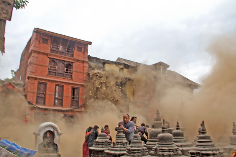 Source: People trying to save themselves as dust engulfs a house in Swayambhu, after the devastating earthquake, on Baisahak 12, 2015. Photo: Deepak Ratna Bajracharya