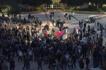 Protestors gather in the street outside the Memorial Student Center in College Station, Tex. on Tuesday, December 6, 2016. (Photo/Laura Thompson, thompson@texasobserver.org)