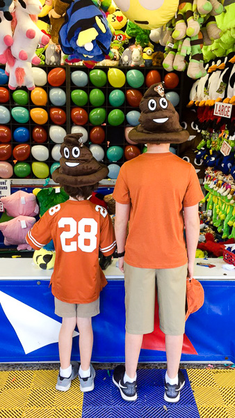 Our boys with their prized poop emoji hats.