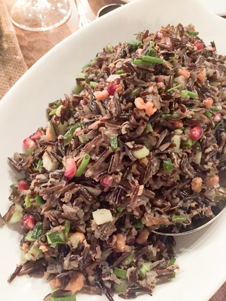 Wild Rice Salad with charred I'itoi onions, pomegranates and toasted walnuts.