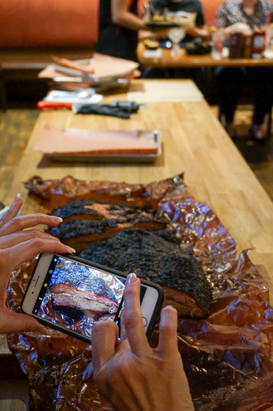 Capturing the unveiling of the brisket.