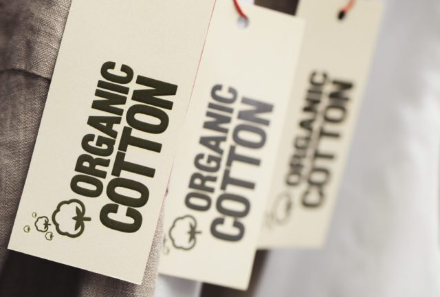 Organic cotton towelling labels on hangers.