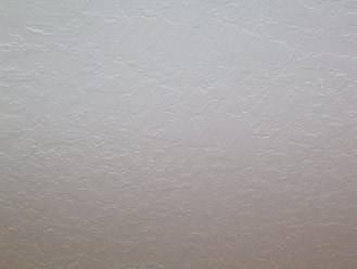 Painted skip trowel ceiling after a ceiling repair
