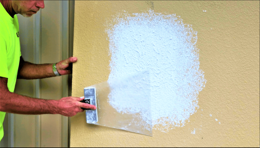 Knocking down the knockdown texture on the wall patch