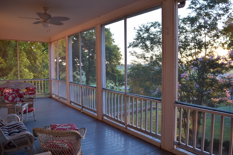 outdoor deck into a screened porch