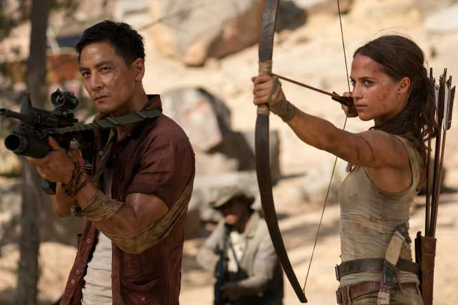 "DANIEL WU as Lu Ren and ALICIA VIKANDER as Lara Croft in Warner Bros. Pictures' and Metro-Goldwyn-Mayer Pictures' action adventure ""TOMB RAIDER,"" a Warner Bros. Pictures release. Photo Credit: Ilze Kitshoff © 2018 WARNER BROS. ENTERTAINMENT INC. AND METRO-GOLDWYN-MAYER PICTURES INC."