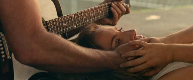 """A STAR IS BORN Copyright: © 2018 WARNER BROS. ENTERTAINMENT INC. AND METRO-GOLDWYN-MAYER PICTURES INC. ALL RIGHTS RESERVED Photo Credit: Courtesy of Warner Bros. Pictures Caption: (L-R) BRADLEY COOPER as Jack and LADY GAGA as Ally in the drama """"A STAR IS BORN,"""" from Warner Bros. Pictures, in association with Live Nation Productions and Metro Goldwyn Mayer Pictures, a Warner Bros. Pictures release."""