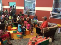 Thelma Perkins Speaking to Children in the Storytelling Room of the SLF.