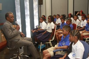 THA Chief Secretary Orville London chats with the students of Biche RC Primary School.