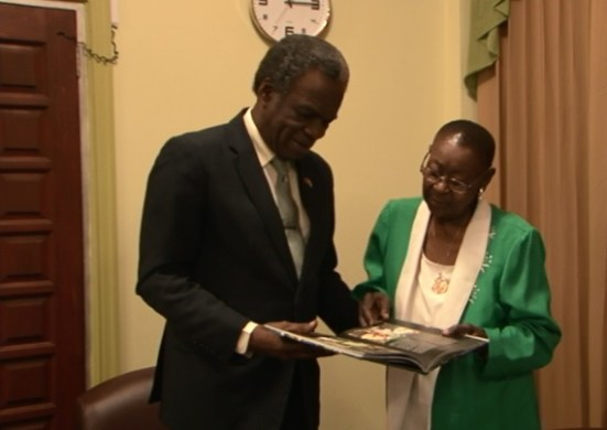 "Chief Secretary Orville London presents the book ""Tobago: Clean, Green and Serene"" to Calypso Rose during Friday's (August 19, 2016) courtesy visit."