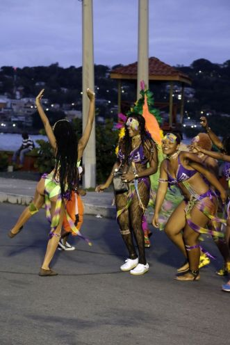 Carnival is Colours masqueraders dance carefree during the Monday night Mas celebrations.