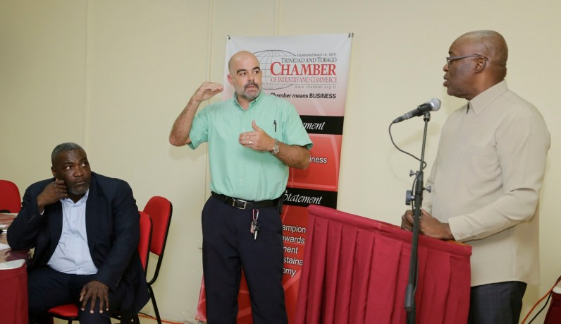 Chairman of the Tobago Division of the T&T Chamber of Industry andCommerce, Demi John-Cruickshank, left, is listening as THA Chief Secretary Kelvin Charles, right,fields a question at the event.