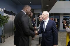 EU delegation leader Aad Biesebroek, right foreground, is welcomed by Community Development Assistant Secretary Shomari Hector. Also in photo, from left, are Settlements Secretary Clarence Jacob, Infrastructure Secretary Kwesi Des Vignes (background), and Netherlands Ambassador Jules Bilj, second from right.