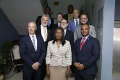 Front row, from left, are EU delegation leader Aad Biesebroek, Community Development Secretary Marslyn Melville-Jack, and Infrastructure Secretary Kwesi Des Vignes; second row: German Ambassador Dr Lutz Goergens, French Ambassador Hedi Piquart and Netherlands Ambassador Jules Bilj; back row: Asst Secretary in the Division of Community Development Shomari Hector, British High Commissioner Tim Stew, Settlements Secretary, Clarence Jacob and Spanish Ambassador Jose Maria Fernandez Lopez de Turiso.