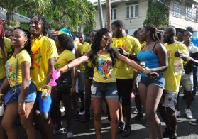 The crowd of revellers dance into daylight at Roxborough's J'Ouvert.