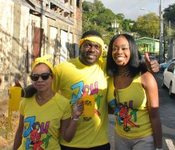 Minority leader Watson Duke, centre, his wife, and Secretary of Tourism, Culture, and Transportation Nadine Stewart-Phillips celebrate Carnival at the Roxborough J'Ouvert.