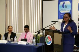Administrator of the Division of Finance and the Economy Claire Davidson-Williams gives the feature address at the World Consumer Rights Day programme. Others at the head table, from left, are Scotiabank's Regional Senior Manager of Investigations and Loss Prevention Jennifer Koo-Rogers and Consumer Affairs Unit Manager Langdon Phillips.