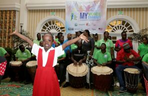 The Technical Vocational Centre for Persons with Disability drummers, background, show off their talent during a drumology session.