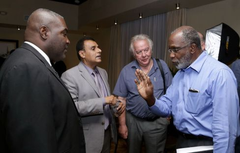 Minister of Works and Transportation Rohan Sinanan, second from left, listens as businessman Claude Benoit, right makes a point during an informal discussion. Also in photo, are president of the Tobago Division of the T&T Chamber of Industry and Commerce Demi-John Cruickshank, left, and president of the Tobago Hoteliers and Tourism Association (THTA) Chris James.