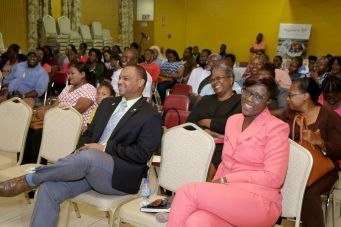 Stakeholders and other guests, among them Secretary for Infrastructure, Quarries and the Environment, Councillor Kwesi Des Vignes, left foreground, listen to a presentation during the event.