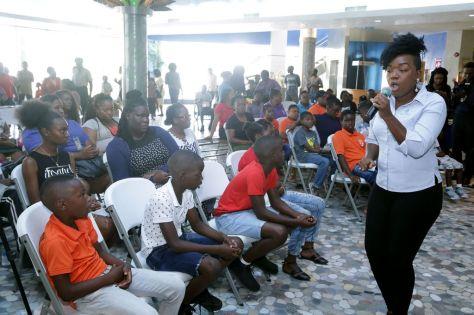 Calypsonian Nicole Thomas entertains the audience.