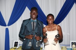 Tyriq Horsford, Male Student Athlete of the Year, and Asha James, Female Student Athlete of the Year, pose with their trophies.