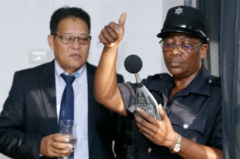 SRP Constable Haniffa Perry demonstrates the use of the sound level meter under the watchful eye of CCPA President Garvin Monzano.