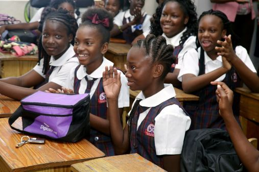 St Andrew's Anglican primary school pupil Kareah Manning acknowledges her name after it was announced that she placed third overall among SEA pupils writing the exam in Tobago.
