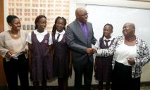 THA Chief Secretary Kelvin Charles congratulates St Andrew's Anglican primary school principal Nicole Henry after four of her pupils placed among the top ten SEA pupils in Tobago. From left are Assistant Secretary Marisha Osmond, Aniela Morris who placed 9th overall, Sheneika Collette who placed fifth overall and Kareah Manning who placed third overall.