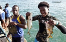 Divers Hasely Roberts, left and Akimbe Parkinson show their catch after they took part in the divers competition.
