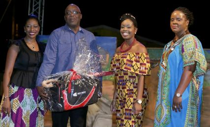 THA Chief Secretary Kelvin Charles, second from left, receives a gift from Unit Trust Corporation's (UTC) chief customer relations officer Karrian Hepburn, left. Also in photo, from left, are Secretary of Tourism, Culture and Transportation Councillor Nadine Stewart-Phillips, second from right, and UTC's Tobago Investment Centre manager Ijeoma De Gale-Henry.