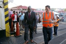 Chief Secretary Kelvin Charles, left, foreground, enters the Cabo Star at the beginning of the tour of the vessel along Brian Grange, president of Bridgeman's Service Group.