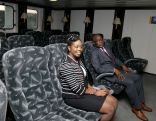 Chief Secretary Kelvin Charles, right, and Secretary of Tourism, Culture and Transportation Nadine Stewart-Phillips in the vessel's passenger lounge.