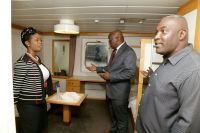 Chief Secretary Kelvin Charles, right, Secretary of Tourism, Culture and Transportation Nadine Stewart-Phillips and chairman of the Tobago branch of the Chamber of Commerce and Industry Demi-John Cruickshank inspect one of the 12 cabins on board the Cabo Star.