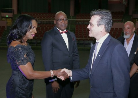 Catherine Anthony-Charles, wife of Chief Secretary Kelvin Charles, greets Richard Blewitt, Resident Representative of the United Nations Development Programme (UNDP).