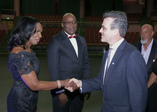 Catherine Anthony-Charles, wife of Chief Secretary Kelvin Charles, greets Richard Blewitt, Resident Representative of the United Nations Development Programme (UNDP).