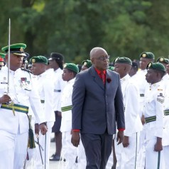 Chief Secretary Kelvin Charles inspects the troops.