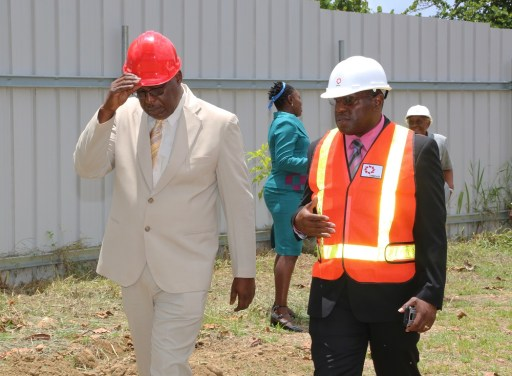 THA Chief Secretary Kelvin Charles, left, and UDeCOTT CEO Frank Barnes talk about the project developments.