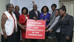 Representatives gather after the signing of the Memorandum Of Understanding signing of the National Workplace Police on HIV and AIDS. From left are Tobago Aids Society representative Gertrude Bernard-Trim, THA Chief Administrator Raye Sandy, Secretary for Community Development, Enterprise Development and Labour Marslyn Melville-Jack, Chief Secretary Kelvin Charles, Minister of Labour and Small Enterprise Development Senator Jennifer Baptiste-Primus, Secretary of Health, Wellness and Family Development Councillor Dr Agatha Carrington, acting Permanent Secretary in the Ministry of Labour and Small Enterprise Development Natalie Willis and Tobago Library Services' head librarian Helen Johnson.