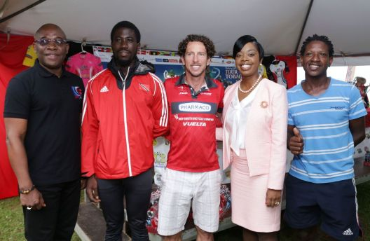 Secretary of Tourism, Culture and Transportation Councillor Nadine Stewart-Phillips, second from right, and NLCB chairman Marvin Johncilla, left, pose for a photo with cyclists, from left, Tobago's Kenvern Brathwaite, former Trinidad and Tobago Pan Am Games silver medallist Emile Abraham and Bronson Chapman at the launch of TICC 2017 on Wednesday (September 27) at Johnson's Apartments, Store Bay.