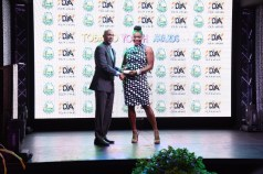 Abeni Taylor receives the Most Improved Youth Organisation award on behalf of the - El Instituto de Idioma from Assemblyman Jomo Pitt, Secretary of Sport and Youth Affairs.