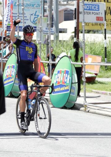 Winner Peter Schulting crosses the finish line at the Tour of Tobago on Sunday (October 1 ,2017).