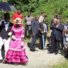 """This Moriah """"couple"""", left, demonstrate the traditional Tobago wedding dance known as the brush back at Fairhill Trace, Moriah, where a mural was created to mark the end of the project. The Trace now also bears the name """"Canada Lane""""."""