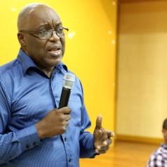 Chief Secretary Kelvin Charles addresses community members.