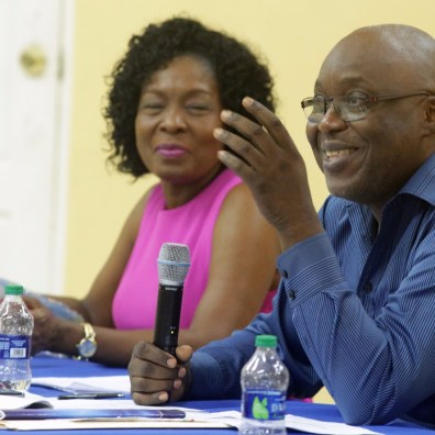 Chief Secretary Kelvin Charles responds to a question from the crowd.