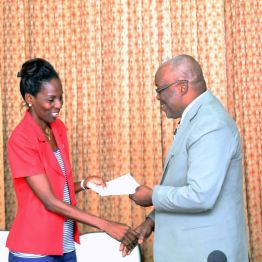 Ria Paria, left, chairman of Autism Tobago, receives funding from Chief Secretary Kelvin Charles on behalf of her organisation.