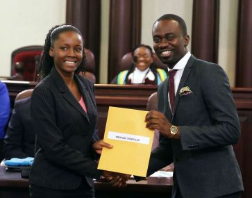 Princess Theroulde receives a certificate of participation from Minority Assemblyman Farley Augustine.