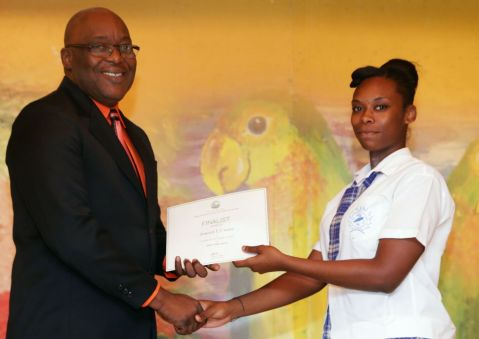 Finalist and Goodwood Secondary School student Shanice Ward receives a certificate from THA Chief Secretary Kelvin Charles.