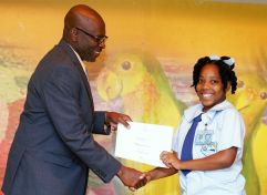 Finalist and Speyside High School student Raeanne Roberts receives a certificate from THA Chief Administrator Raye Sandy.